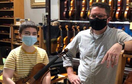 customer receiving custom designed adapted viola from luthier Noah Scott