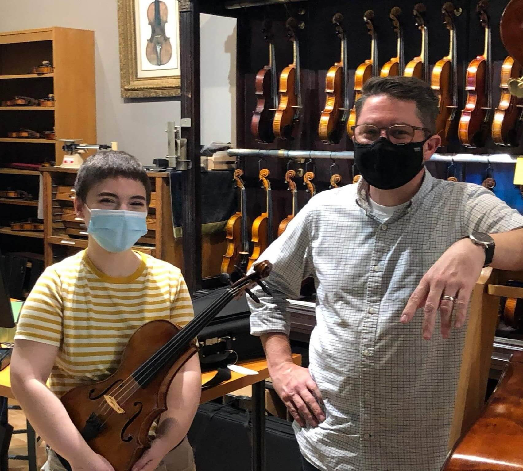 customer receiving custom designed adapted viola from luthier Noah Scott