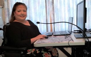 Donna at her accessible work station