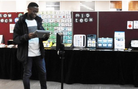 Young man with ipad on demo center