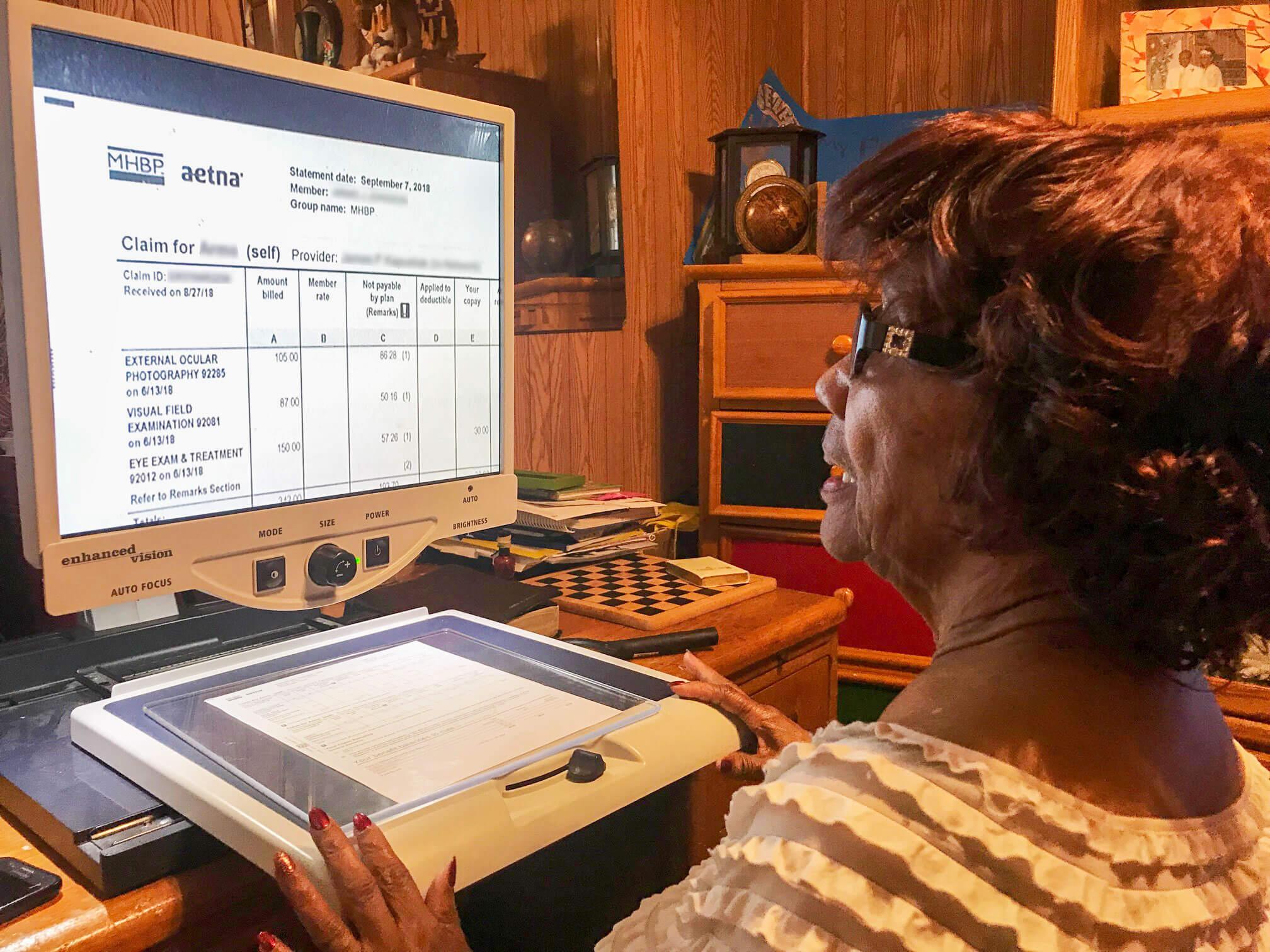 Woman using desktop video magnifier