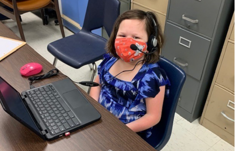 Middle school student using accessibility features on her chromebook.
