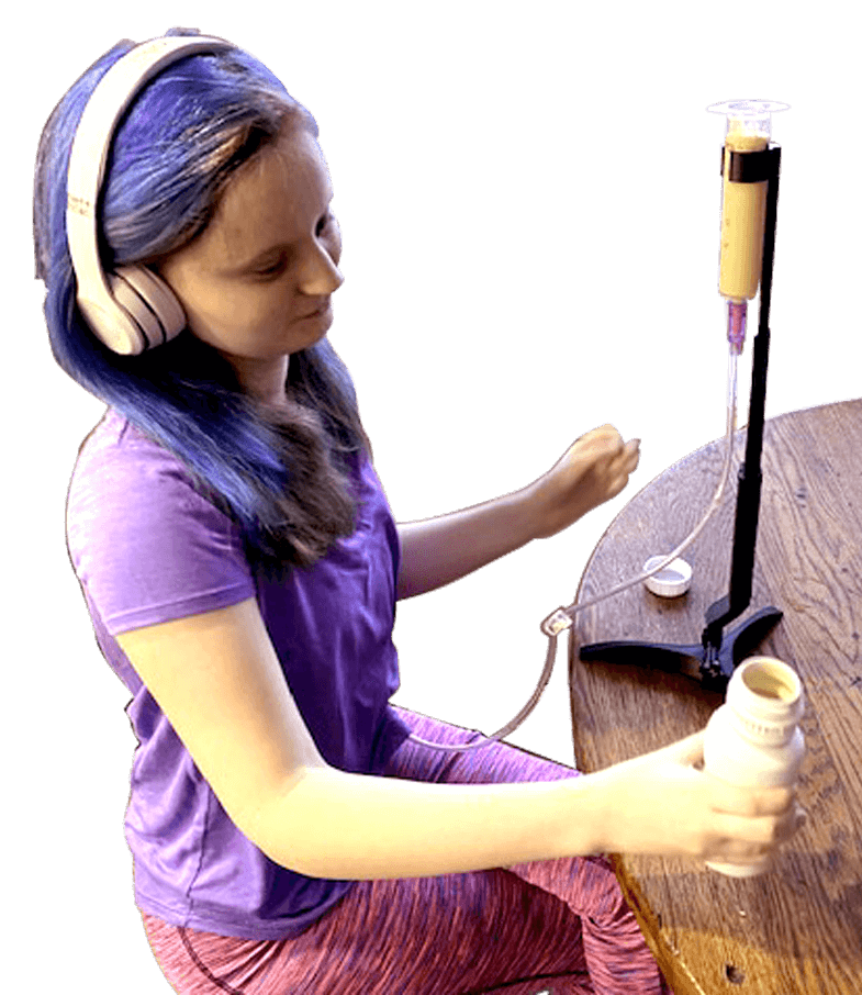 young woman wearing headphones using a g-tube